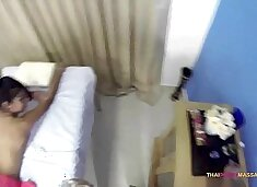 Skinny Oriental allows masseur to roam her naked body