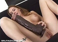 Petite Jenna fills her pussy with a thick b. dildo