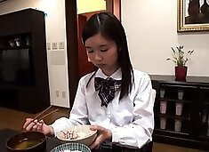 Two horny Asian schoolgirls share a hard dick and a hot load