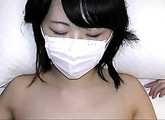 Sweet Asian schoolgirl with tiny tits gets banged on the bed